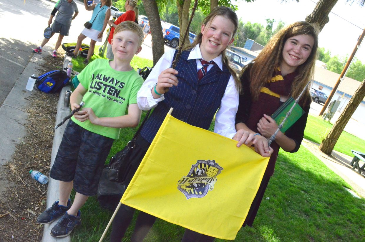 "From left, Dustin Santistevan, Nevaeh Allen and Jillian Bennett wield their magic wands in preparation for ""Harry Potter"" activities during Downtown Business Association's Friday Fest in Alice Pleasant Park. Despite Santistevan, 9, being dressed as Slytherin's Draco Malfoy and Allen and Bennett, both 12, each in costume as Hermione Granger, of Gryffindor, they were all sorted onto the Hufflepuff team based on their birthdates."
