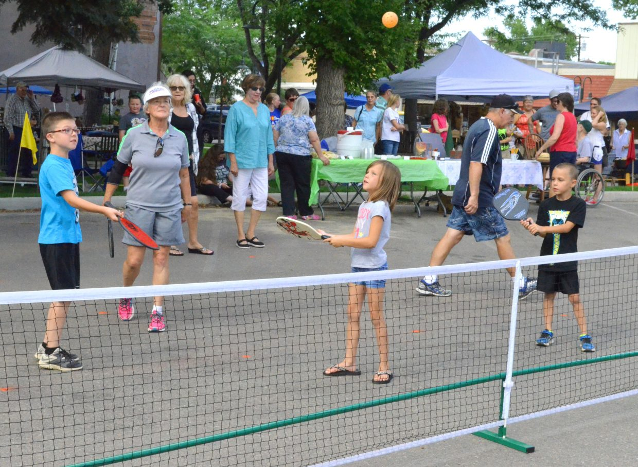 "Players of all ages engage in a round of pickleball as part of Downtown Business Association's Friday Fest in Alice Pleasant Park. The most recent installment of the weekly happening featured ""Harry Potter""-themed activities in honor of a new book being released."