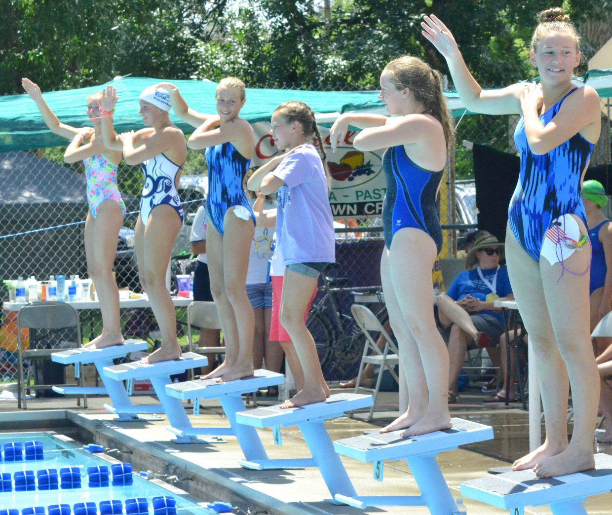 "Swimmers hop onto the starting blocks at the Craig Pool Complex to dance to ""Macarena"" between races at the Seasonal State Meet."