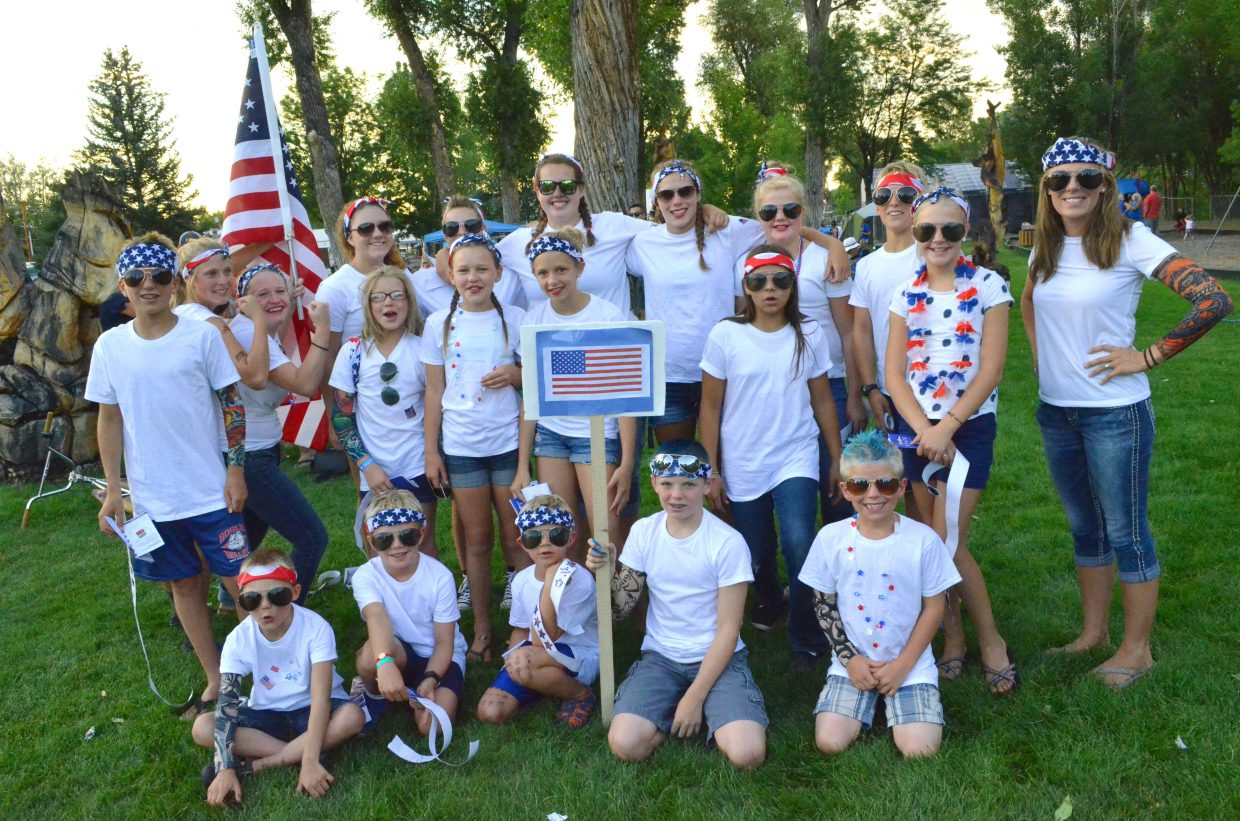Craig Sea Sharks show their national pride Friday in Veterans Memorial Park as part of the Seasonal State Meet. The youth swimming event included an Olympic ceremony, with the hosting Craig team portraying the United States.