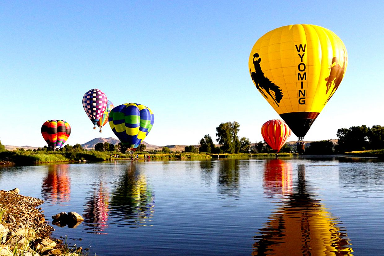 Craig professional photographer Patti Mosbey snapped this colorful photo of hot air balloons taking flight Sunday morning on the final day of the 2016 Moffat County Hot Air Balloon Festival.