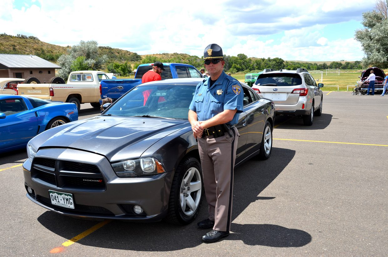 State Patrol Captain Doug Conrad shows off one of his patrol cars at the Colorado Cruisers Classic Car Show Saturday.