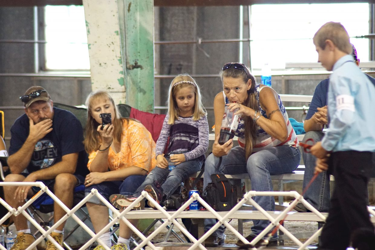 The Burkett family watches the competition closely as Tyler Burkett takes his dog around the ring during the 2016 Moffat County Fair 4-H Dog Show.