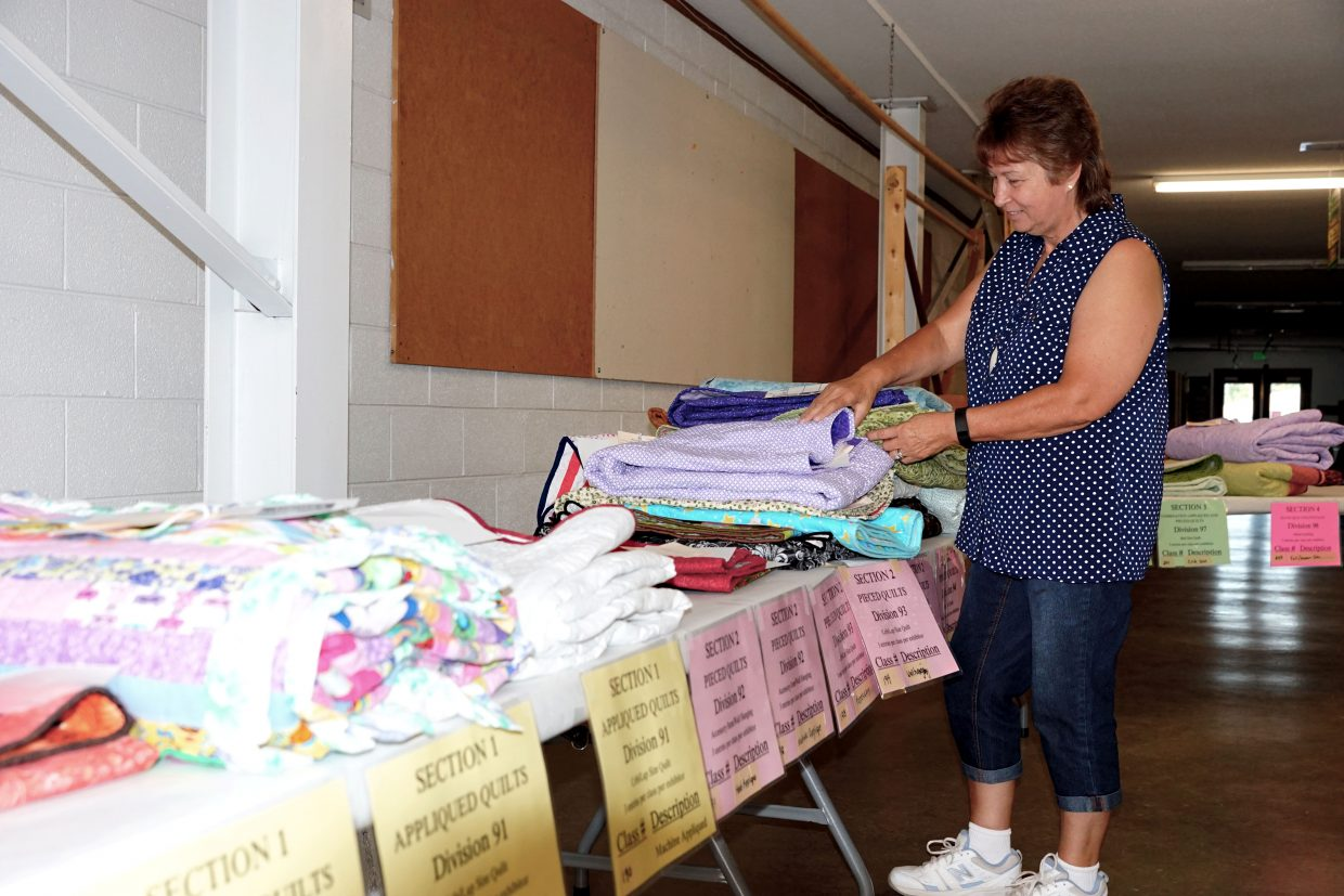 Sharon Gent examines one of the many quits entered in the 2016 Moffat County Fair. Quilts and 4-H projects may be found in the building under the grandstands.