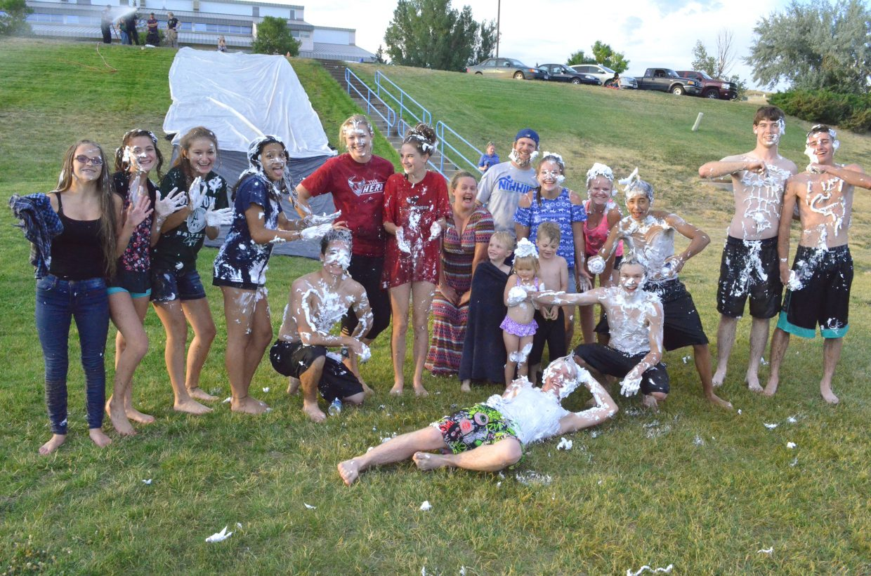 Participants gather at the bottom of the Slip 'N Slide along the Moffat County High School hill following messy fun Wednesday.