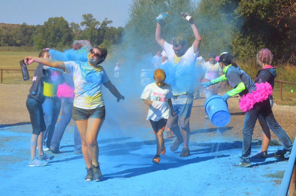 Runners get a healthy coating of blue powder midway through The Color Dash 5K Saturday at Loudy-Simpson Park.
