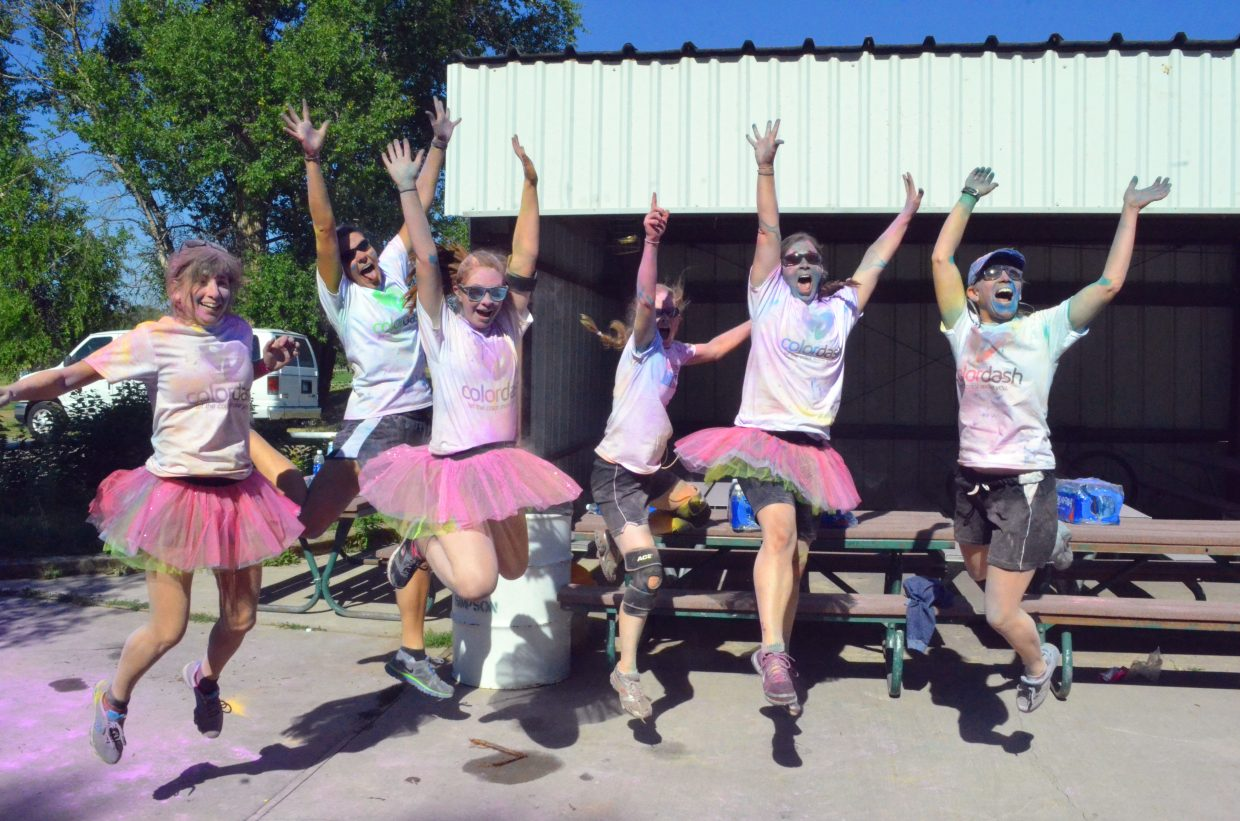 Runners celebrate a race well done after The Color Dash 5K Saturday at Loudy-Simpson Park.