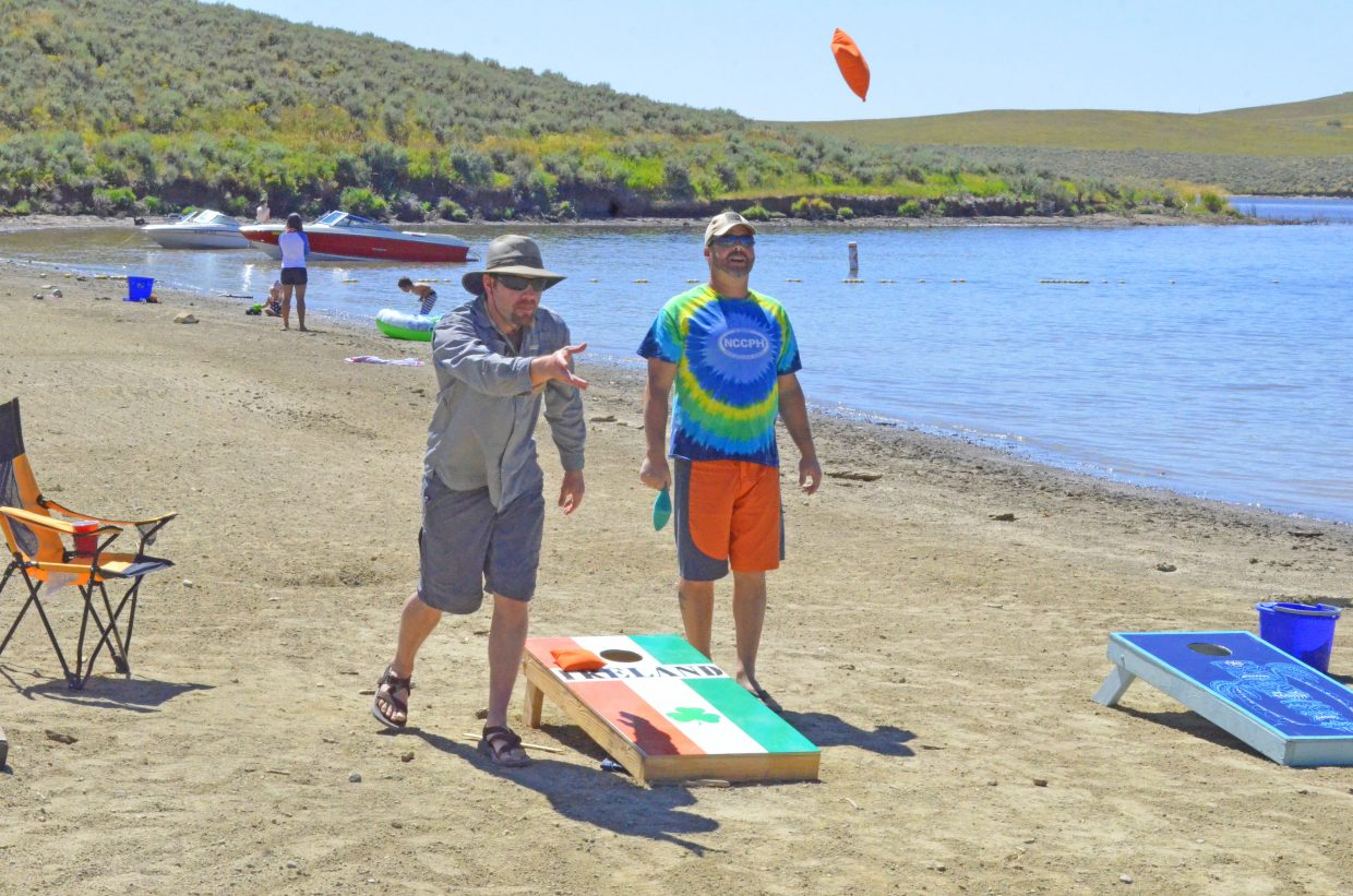 Members of the Northwest Colorado Chapter of Parrotheads get involved in a cornhole tournament during the group's Luau at the Lake Saturday at Elkhead Reservoir.