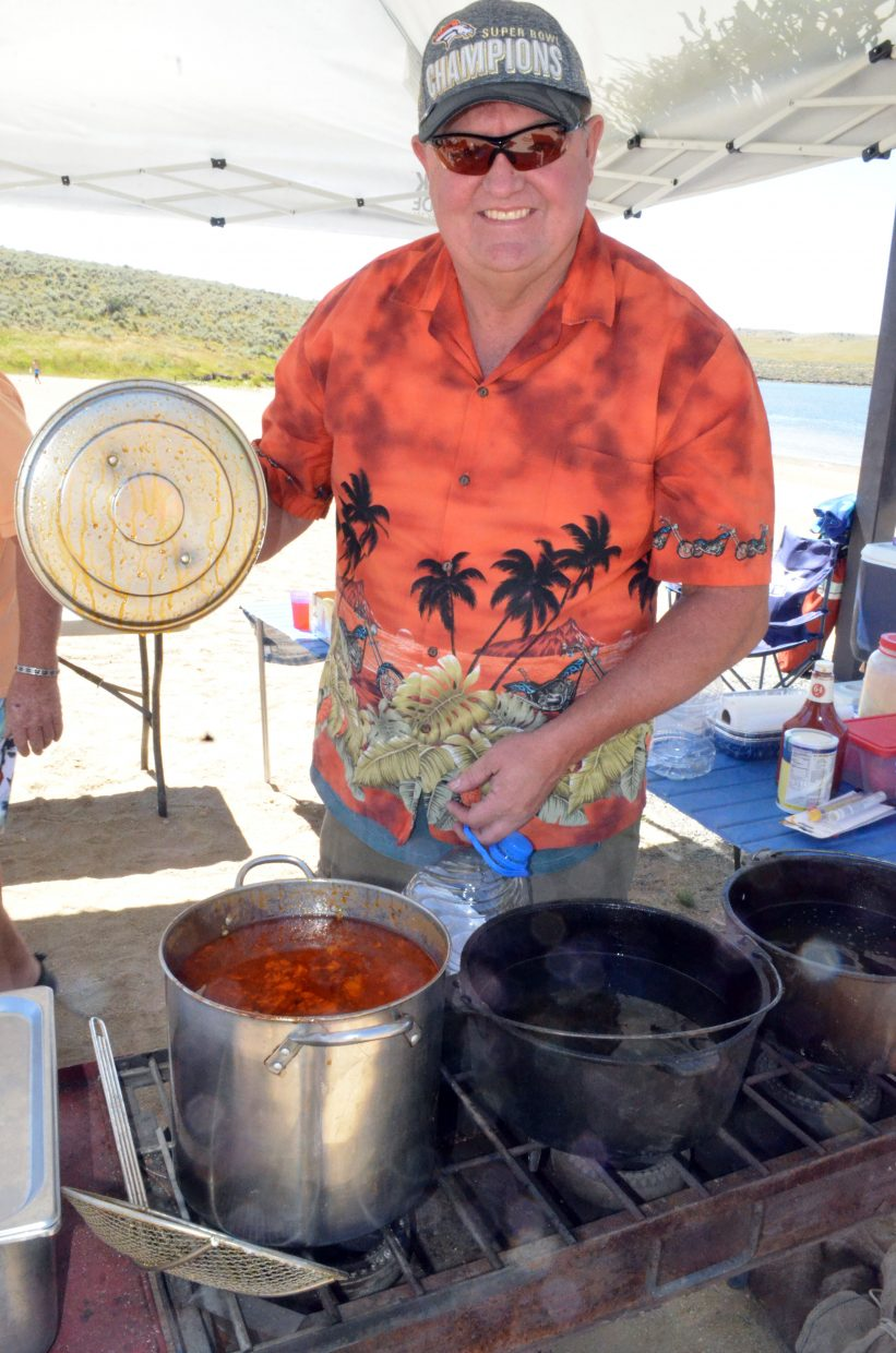 Don Smith displays the pot of gumbo on the menu as part of the Northwest Colorado Chapter of Parrotheads Luau at the Lake Saturday at Elkhead Reservoir.