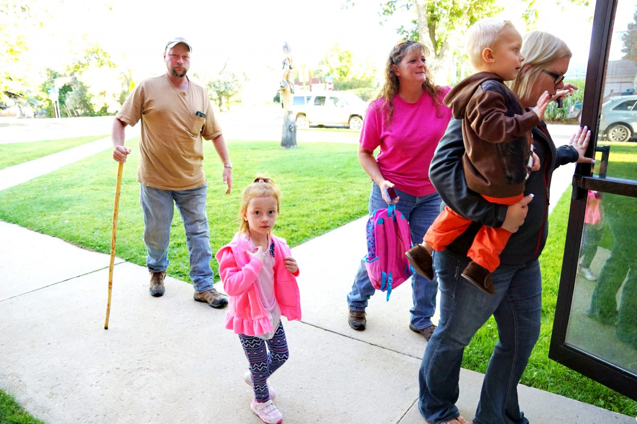 Parents escort students into the Moffat County School District Early Childhood Education Center for the start of the 2016 school year.