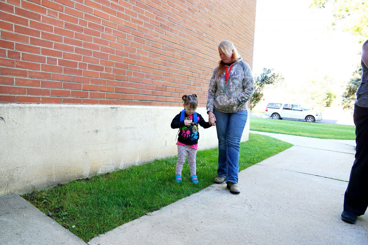 Mother and daughter wait for the doors to open for the 2016 first day of the preschool at Moffat County School Districts Early Childhood Center in Craig.