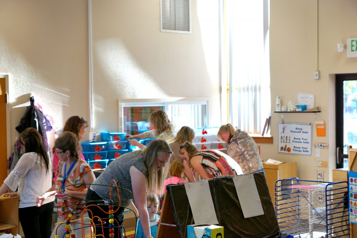 Teachers welcome preschool students at the start of the 2016 school year at the Moffat County Early Childhood Center.