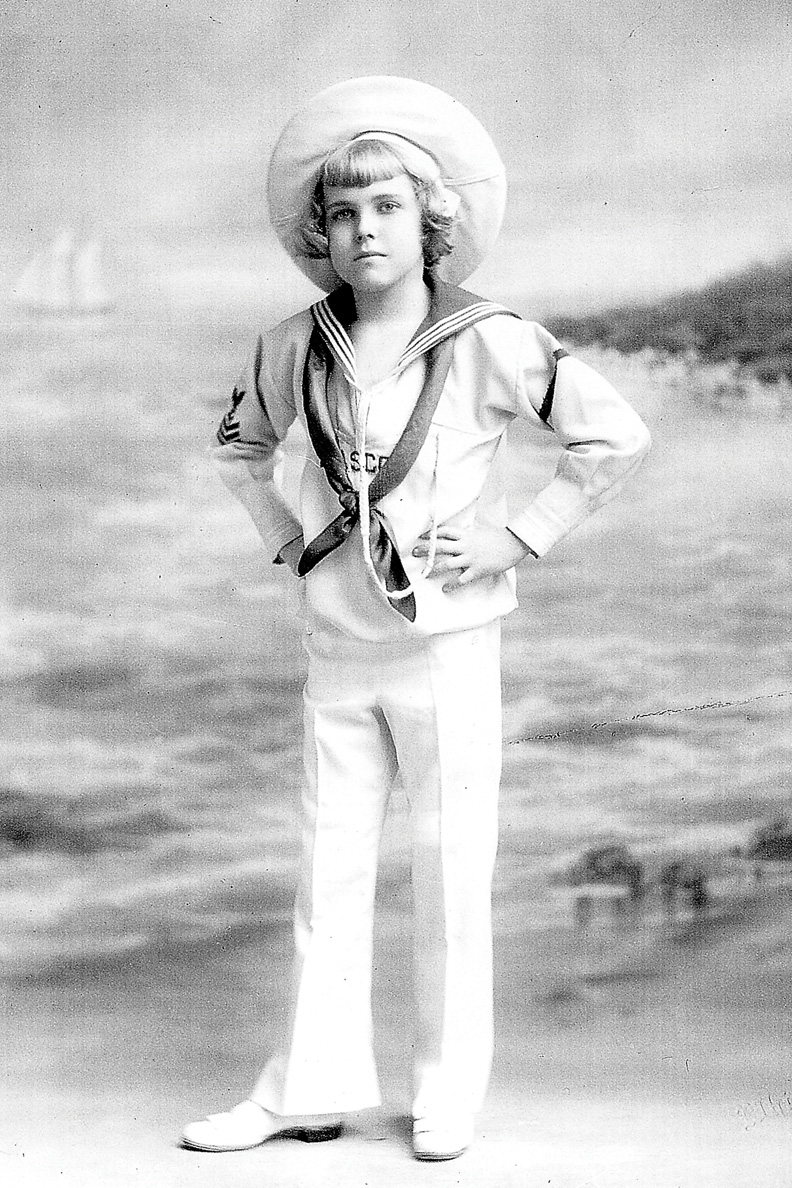 Richard Barker, shown here as a youth, is dressed like the Brown Shoe Company's promotional cartoon, Buster Brown. Barker impersonated the cartoon and appeared in advertising shows until he was 14, but had dreams of moving to the West to become a cowboy.
