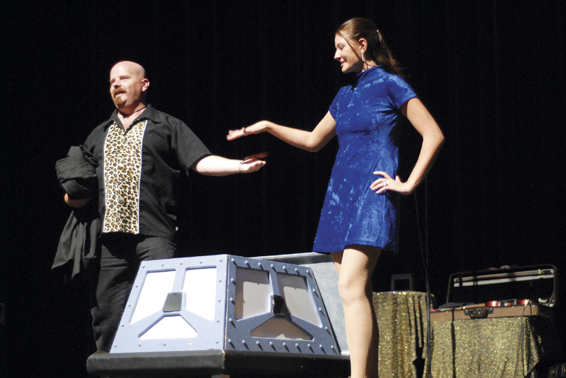 Lanny Kibbey performs the sword in the box trick with assistant Christina Morgan.