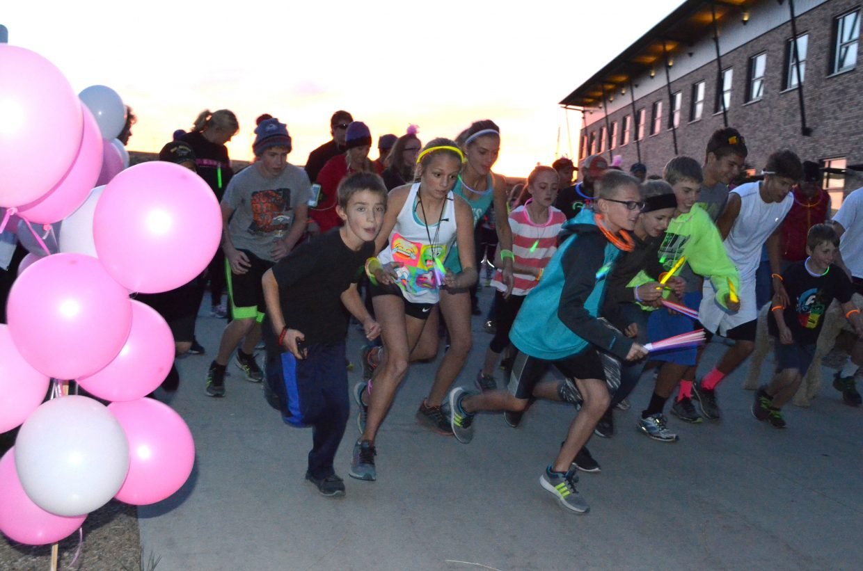 Runners get moving as The Memorial Hospital Glow Run 5K begins Saturday. The running event was a fundraiser for Moffat County Cancer Society and TMH Foundation.