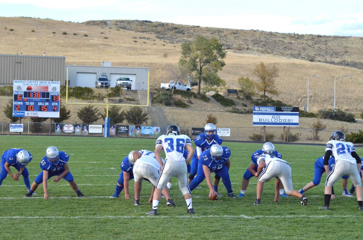 The Moffat County High School junior varsity offense lines up late in the game Monday in the hopes of a score against Coal Ridge. Bulldogs fell, 13-6.