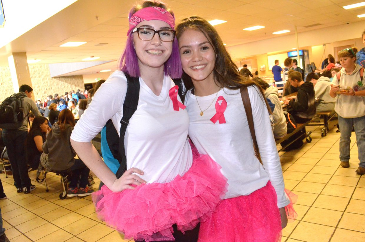 Moffat County High School students Kaysee McCammon, left, and Marlyn Arellano take a break from lunch to show off their matching ensemble as part of Twin Day Tuesday during MCHS Homecoming Week. The two chose pink ribbons and tutus in honor of Breast Cancer Awareness Month.