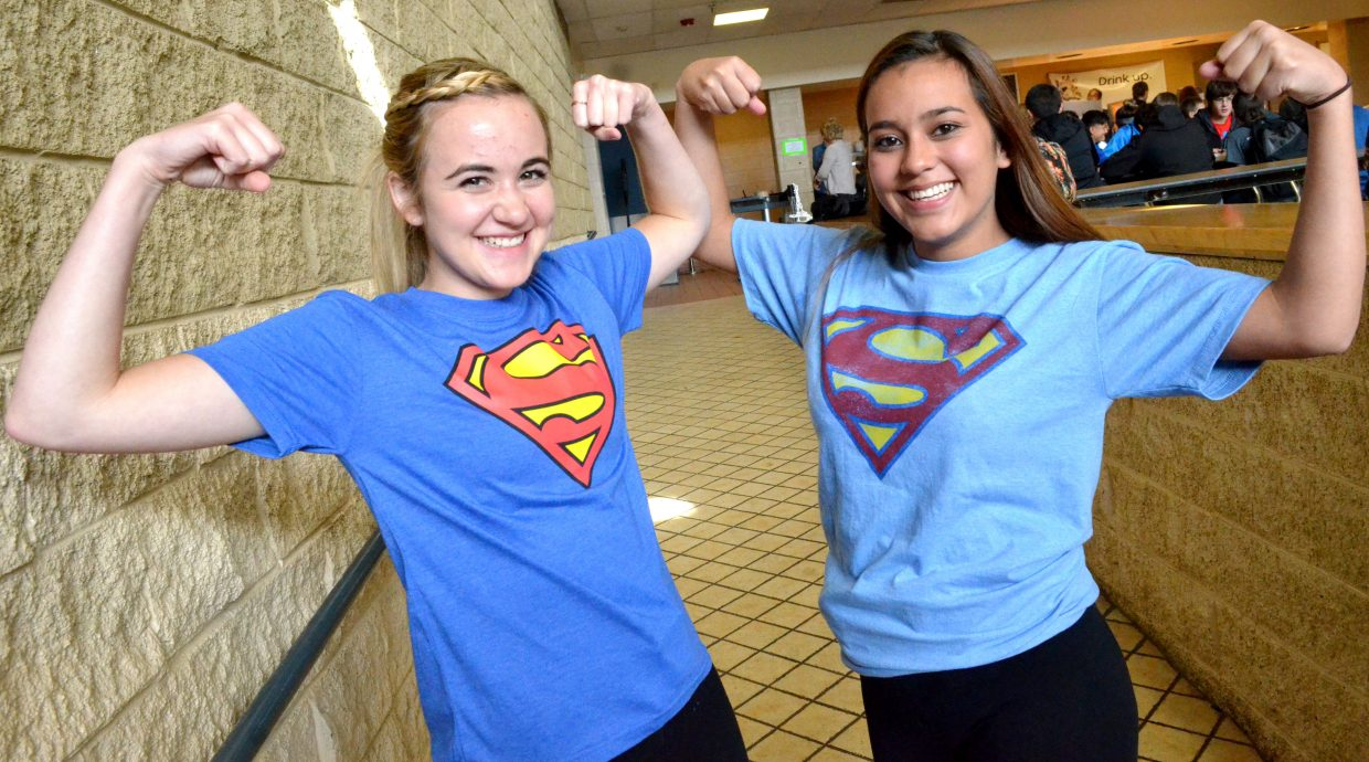 Moffat County High School's Melissa Zimmerman, left, and Naomi Torres strike a superhero pose as part of Twin Day Tuesday during MCHS Homecoming Week.