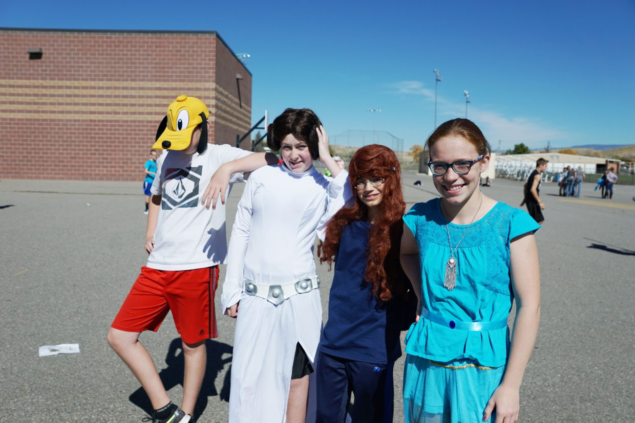 "Disney/Pixar Homecoming Week dress up day was a big hit for CMS seventh-graders Evan Allen who dressed as Disney's Pluto, Alexander Nichols who dressed as Princess Leia from ""Star Wars,"" Kadin Hume who dressed as Miranda from the movie ""Brave"" and Jessica Womble who dressed as Jasmine from the movie ""Aladdin."""