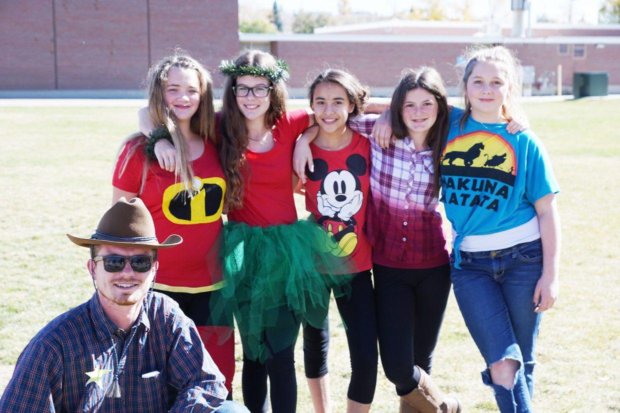 "Teachers and students at Craig Middle School got behind the Homecoming Week dress-up day theme of Disney/Pixar on Thursday. Brant Fuller, seventh-grade English teacher dressed as Sheriff Woody from the ""Toy Story"" movies and behind him are Lauryn Jones, Karrina Romero, Mackenzie Kulp, Payton Butler, and Rieley Winn all are in the seventh grade."