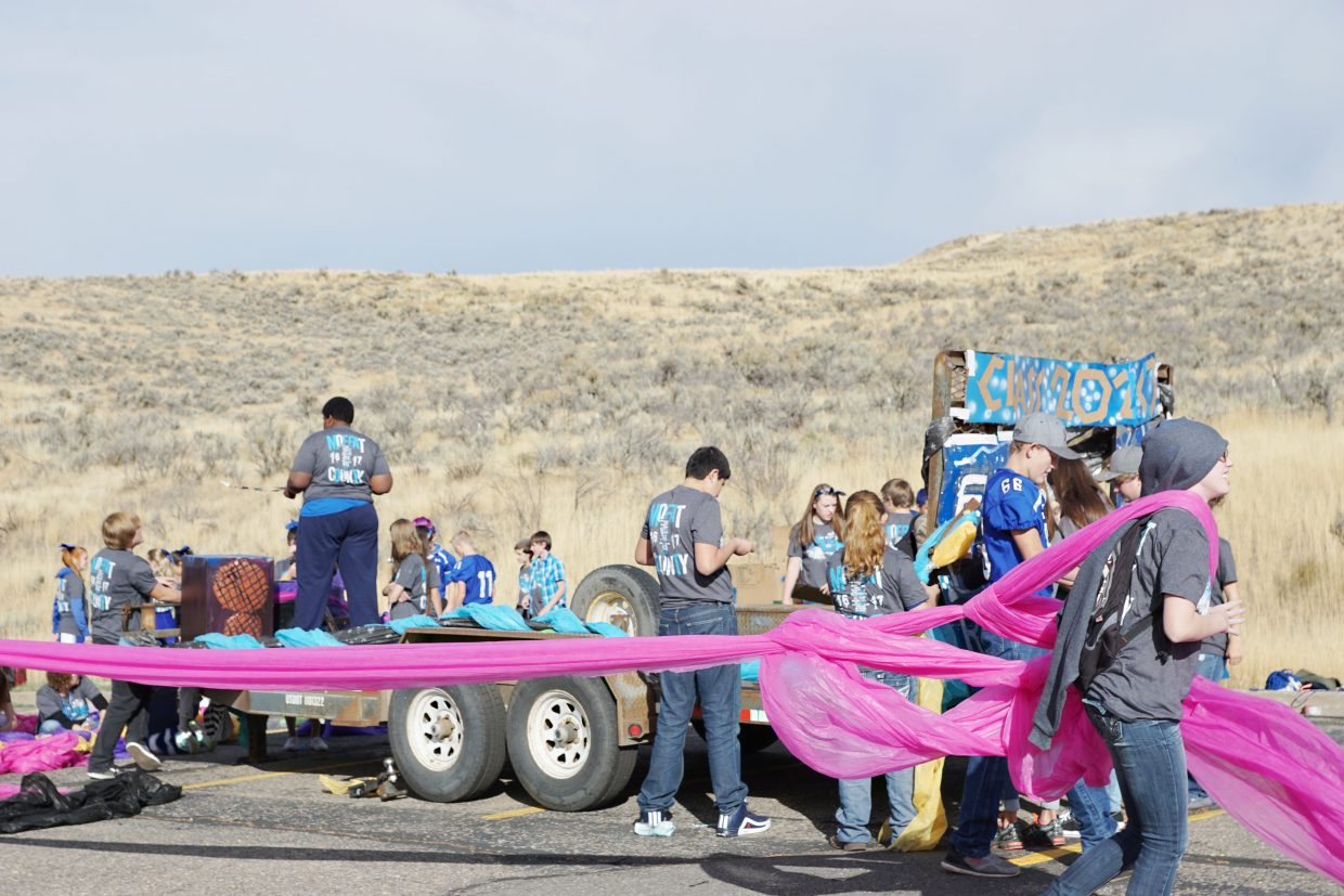 Moffat County High School Freshman Class worked together using fabric, spray paint and cardboard to create their float for the 2016 Homecoming parade Friday morning at the High School.
