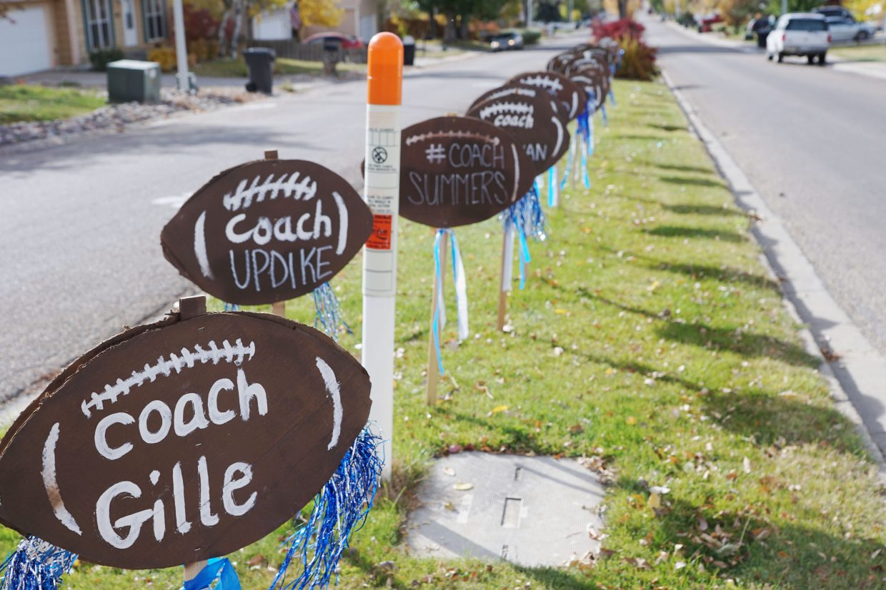 Football shaped signs celebrate the Moffat County High School football team on the approach to the High School proving grounds on Finley Lane in Craig.