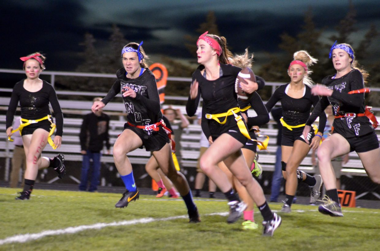 Moffat County High School's Bailey Lawton gains some speed on a rush play for the team BFB as part of the Homecoming Week Powder Puff Football tournament.