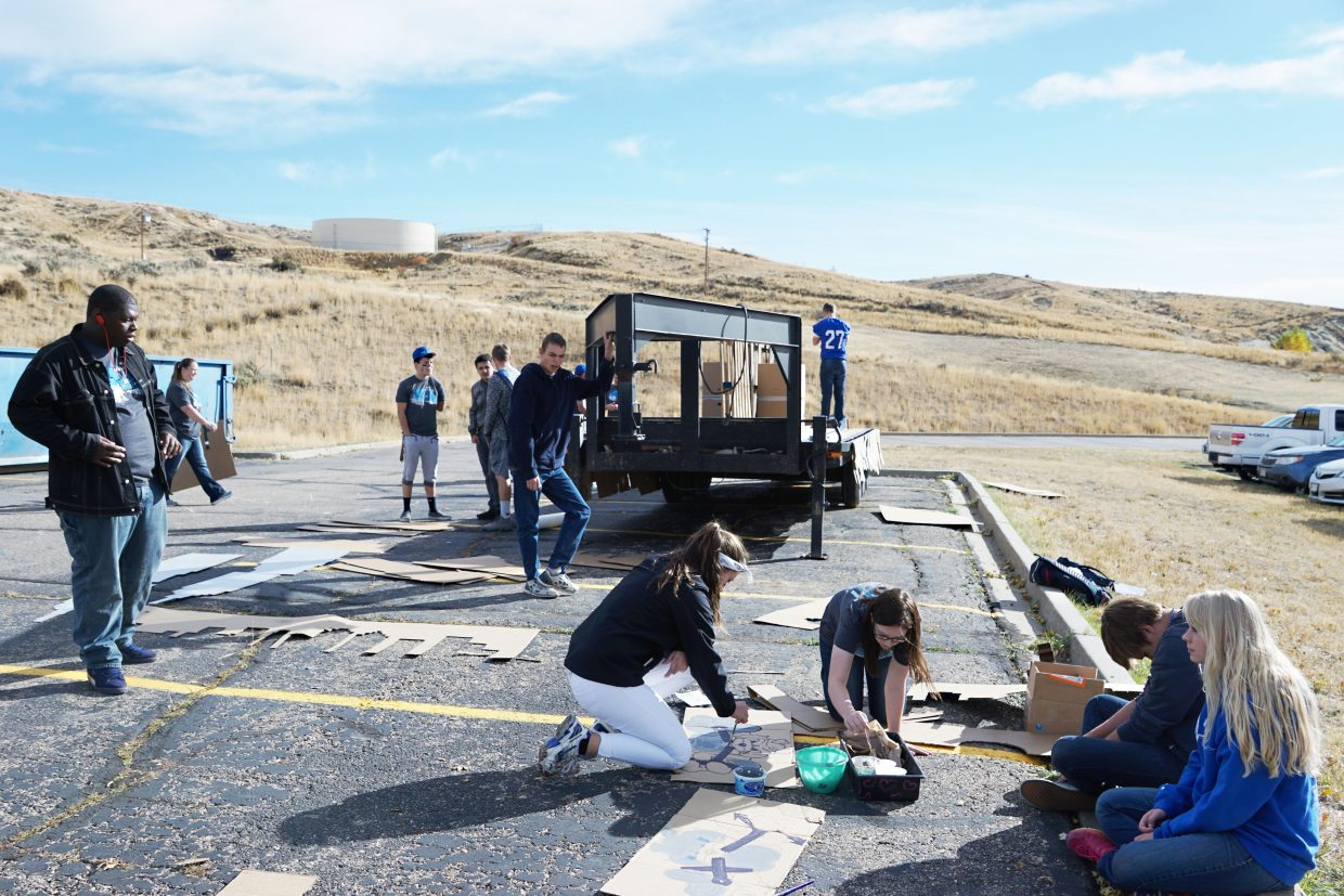 The Senior class at Moffat County High School began to build their 2016 Homecoming Parade float on Friday morning using pallets, paint and cardboard to bring together the theme of New York New York and Bulldog pride.