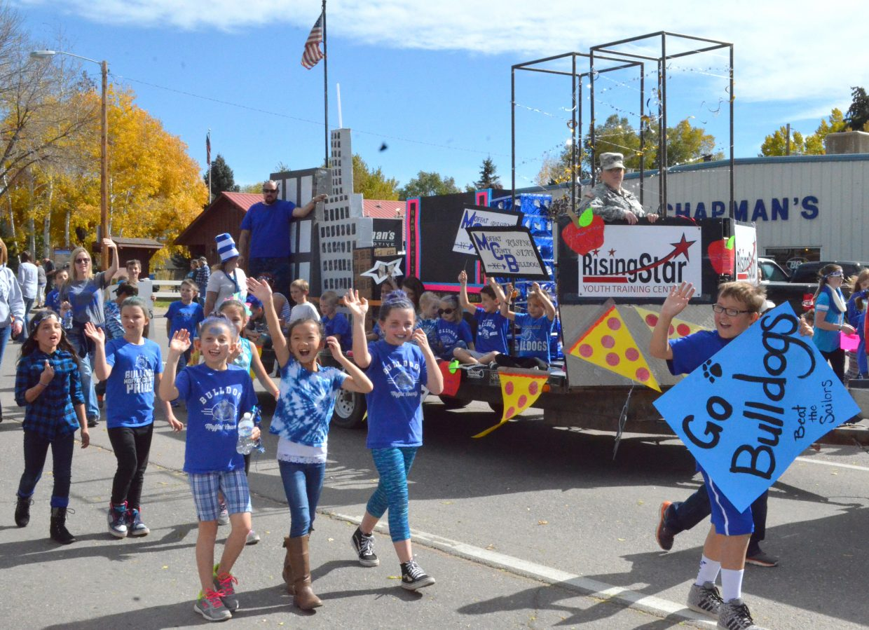 Members of Rising Star Youth Training Center show their local spirit during the Moffat County High School Homecoming parade Friday afternoon. Students and community members were out in great numbers to demonstrate Bulldog pride.