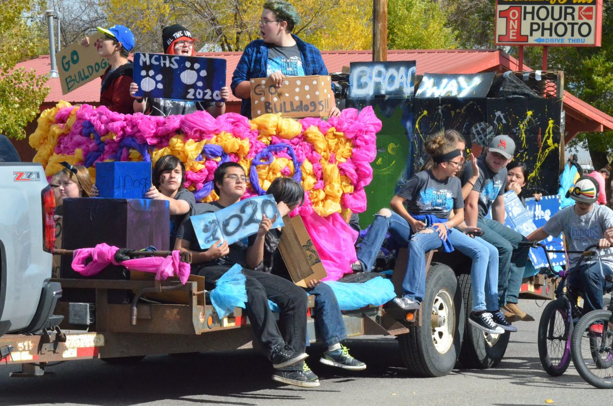 Moffat County High School freshmen show off the flash of their Homecoming float Friday.