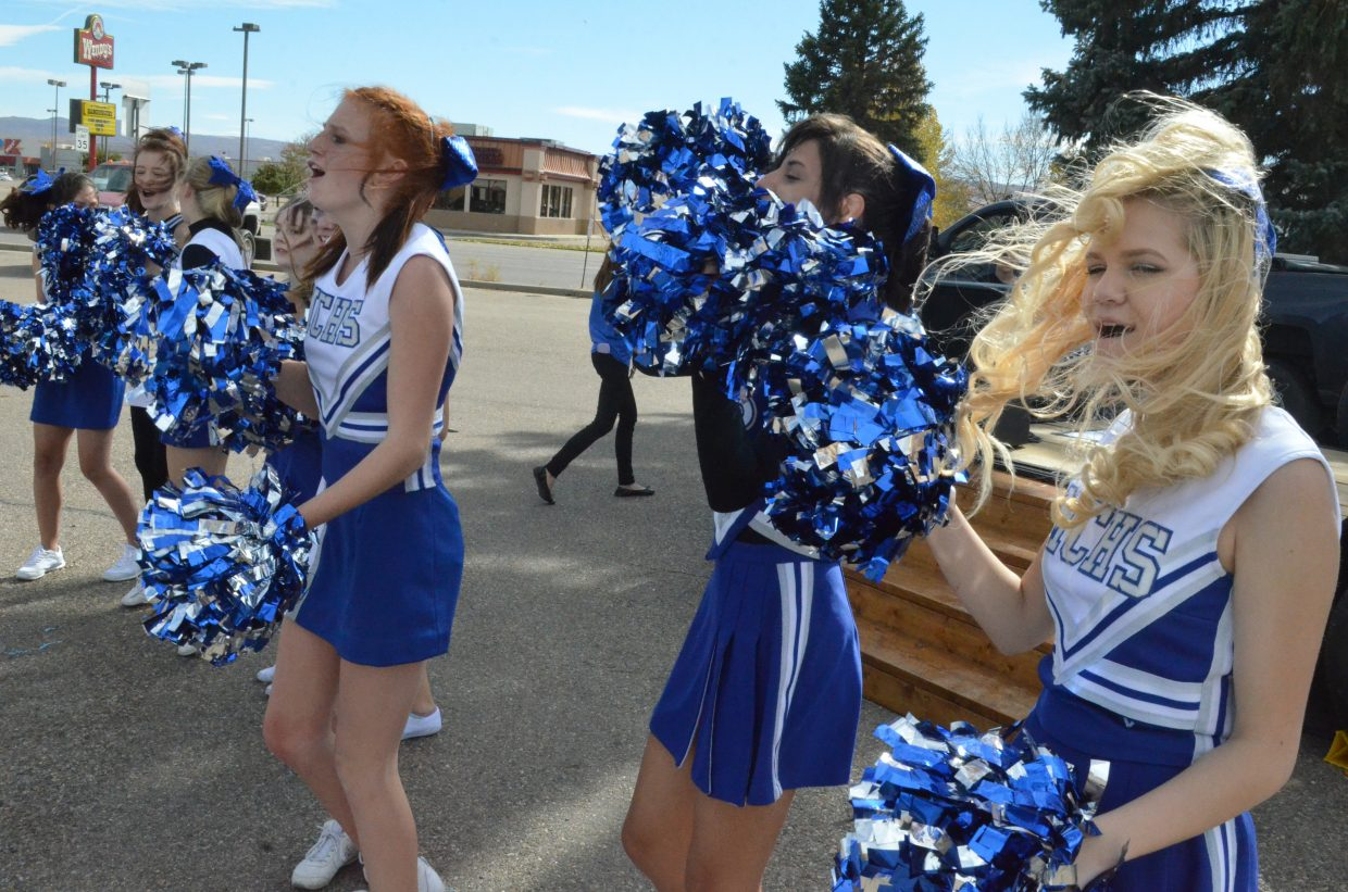 Moffat County High School cheerleaders get the crowd going during the Homecoming community pep rally Friday.