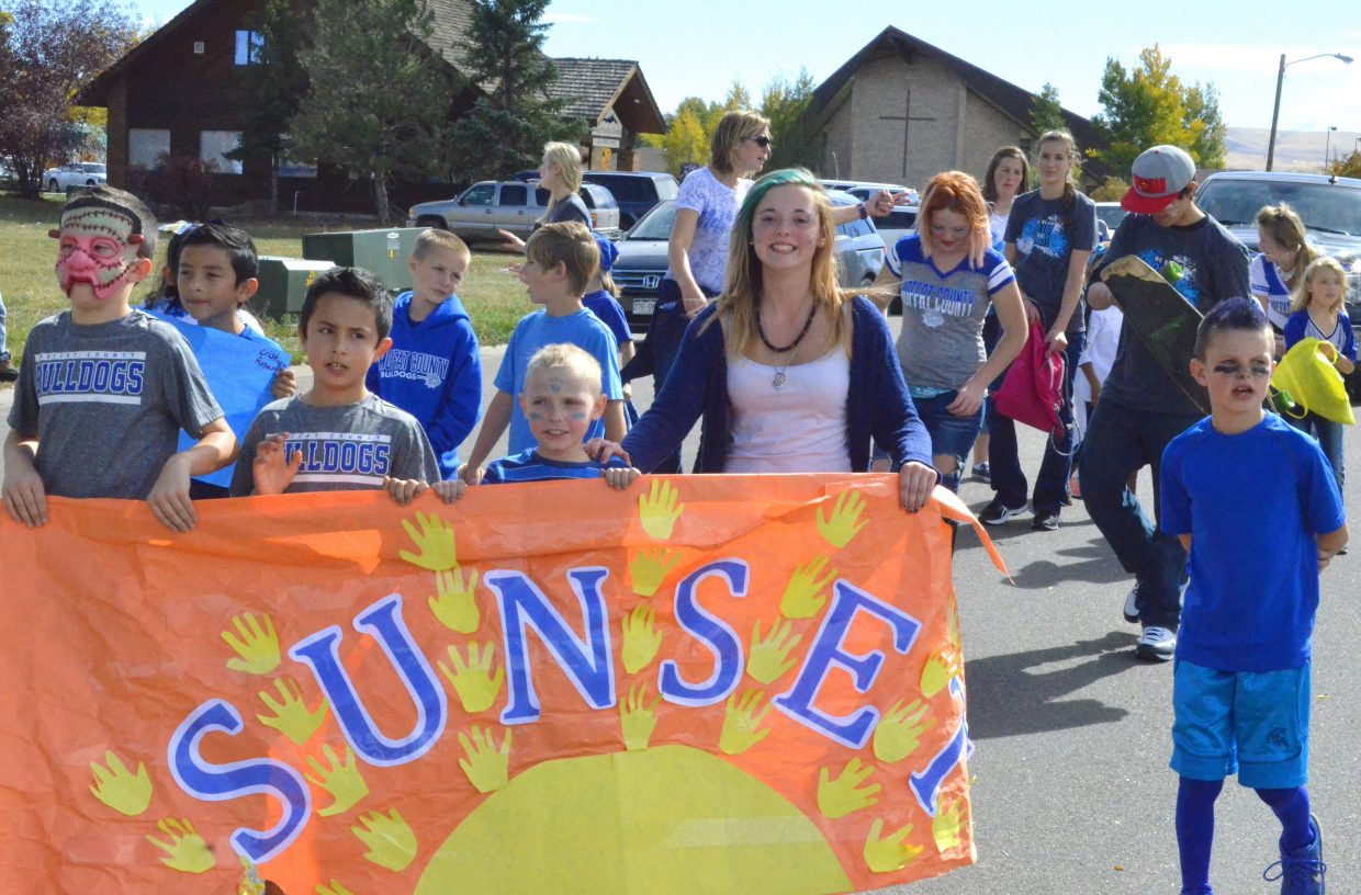 Sunset Elementary School shows its colors during the Moffat County High School Homecoming parade Friday.