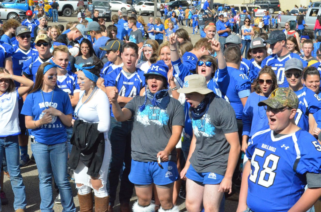 A sea of blue and white fills the Safeway parking lot Friday during Moffat County High School Homecoming community pep rally.