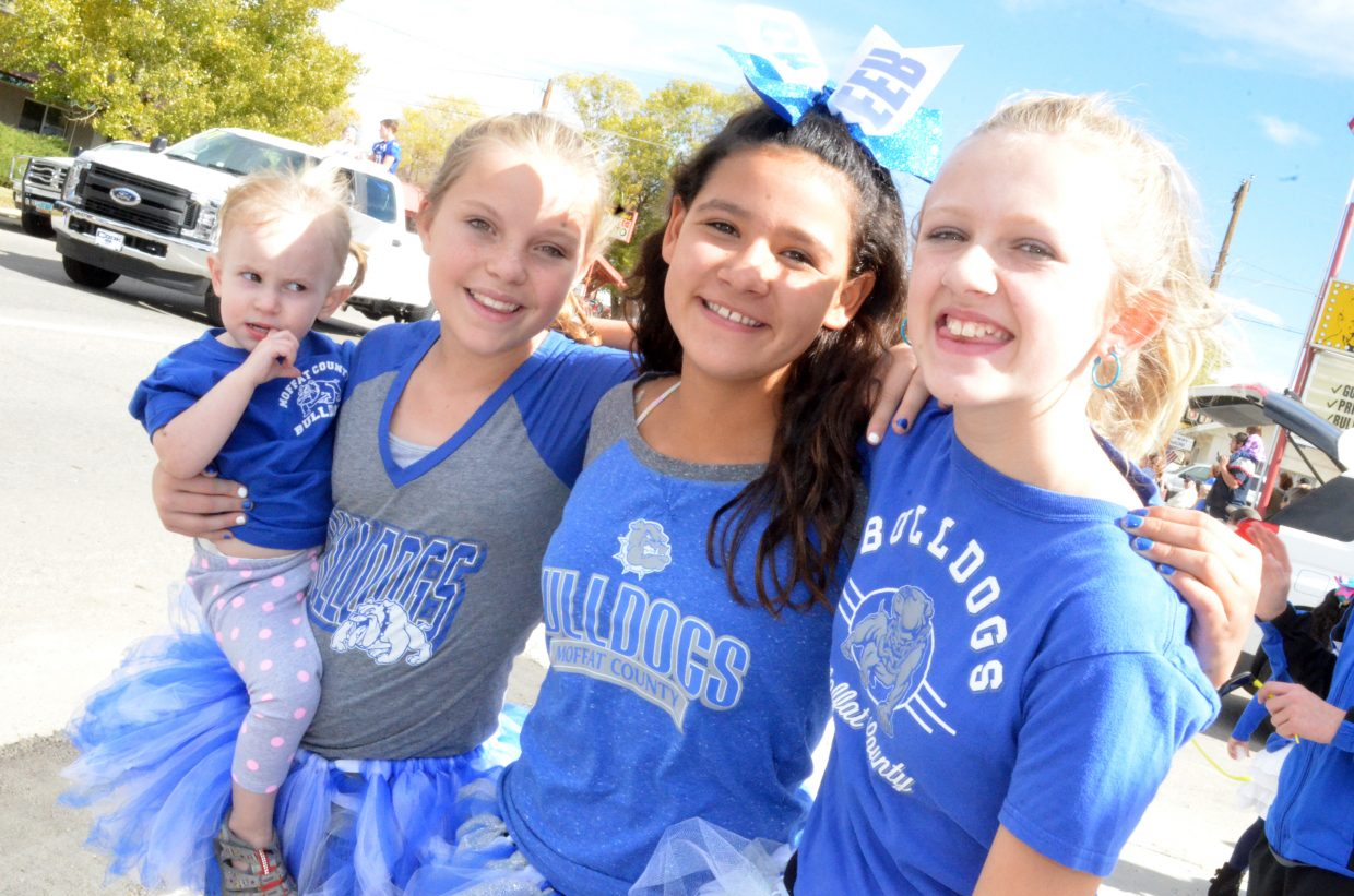 From left, Paisley White, Aftyn Kawcak, Shay Wait and Marlee Fedinec enjoy the Moffat County High School Homecoming parade from the sidewalk along Victory Way.