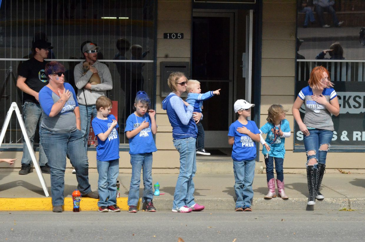Spectators await the start of the Moffat County High School Homecoming parade from the sidewalk along Victory Way.