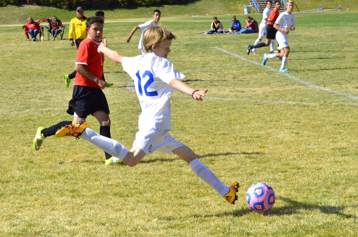 Moffat County High School's Canyon Chambers lines up a pass during Saturday's soccer game against Grand Valley. Bulldogs beat the Cardinals, 5-1, for homecoming.