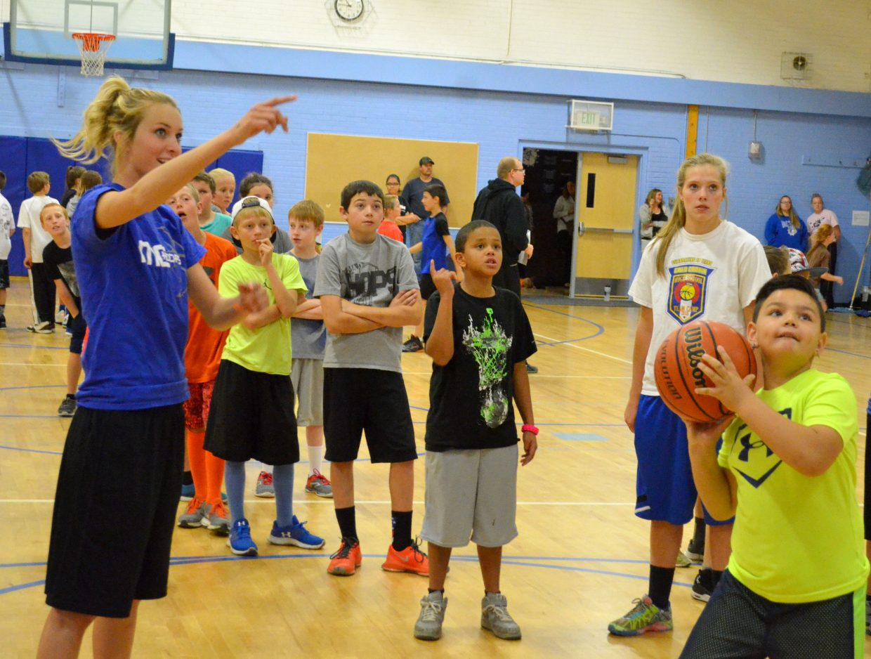 Moffat County High School girls basketball players Kinlie Brennise and Jaci McDiffett instruct shooting during a Lady Bulldogs basketball camp Saturday at Craig Middle School. The MCHS hoops program guided boys and girls in the Craig Parks & Recreation league.
