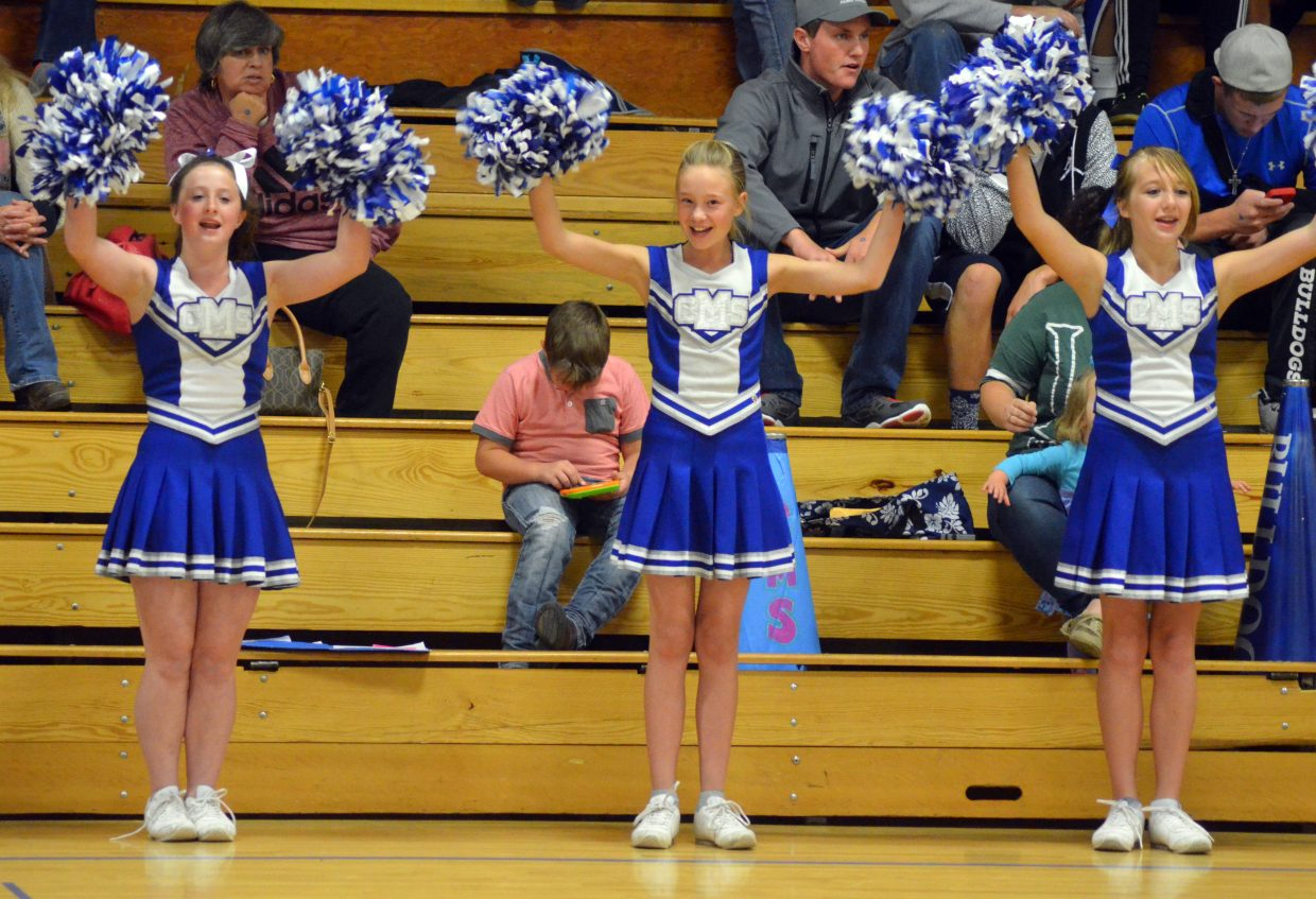 Craig Middle School cheerleaders keep spirits high during the Thursday eighth-grade boys basketball game.