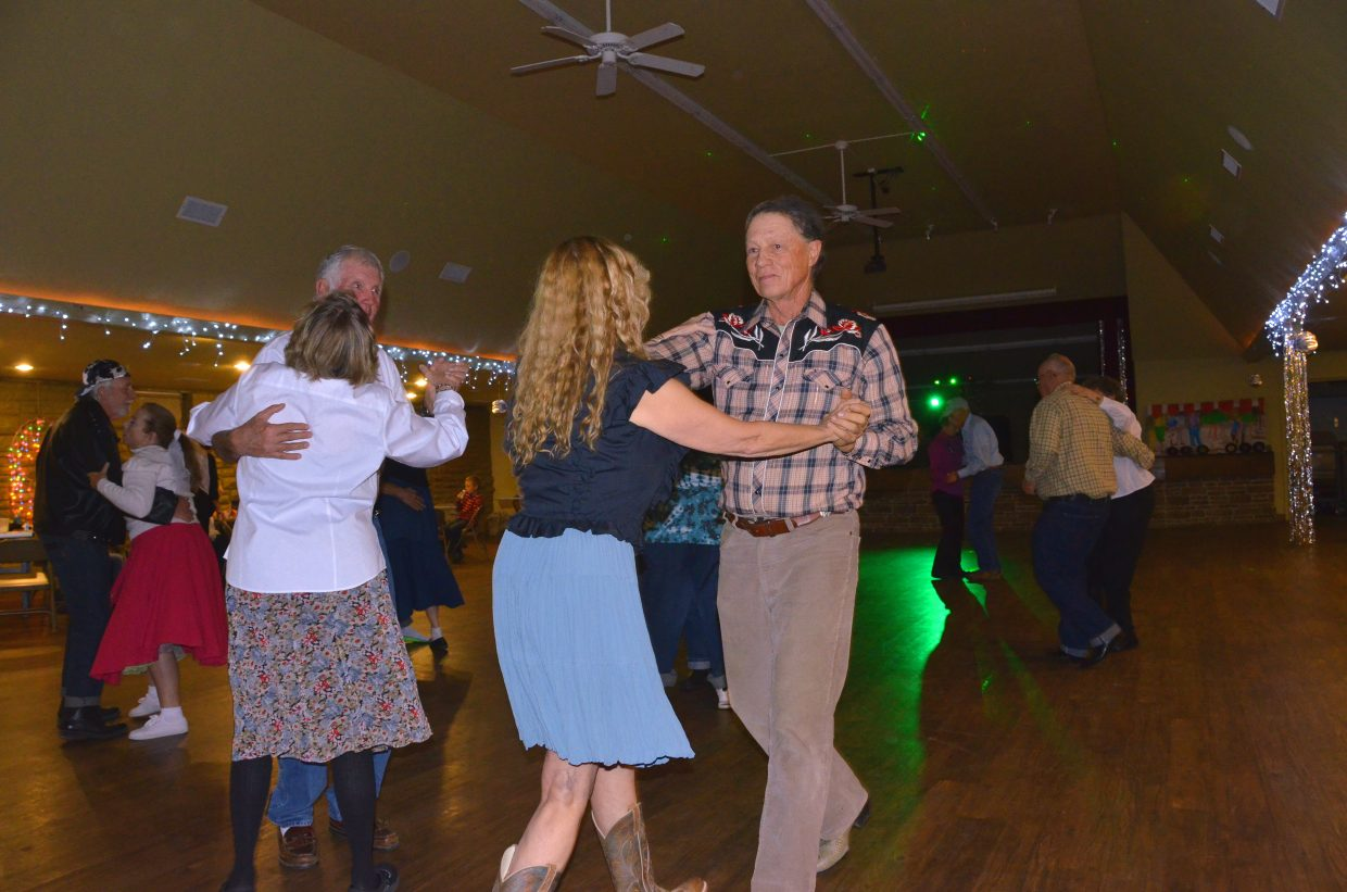"Couples sway to the sounds of Bobby Darin's ""Mack the Knife"" during the Sock Hop fundraiser for the Senior Social Center held Saturday night at the Moffat County Fairgrounds Pavilion. The dance for all ages included concessions, door prizes and more."