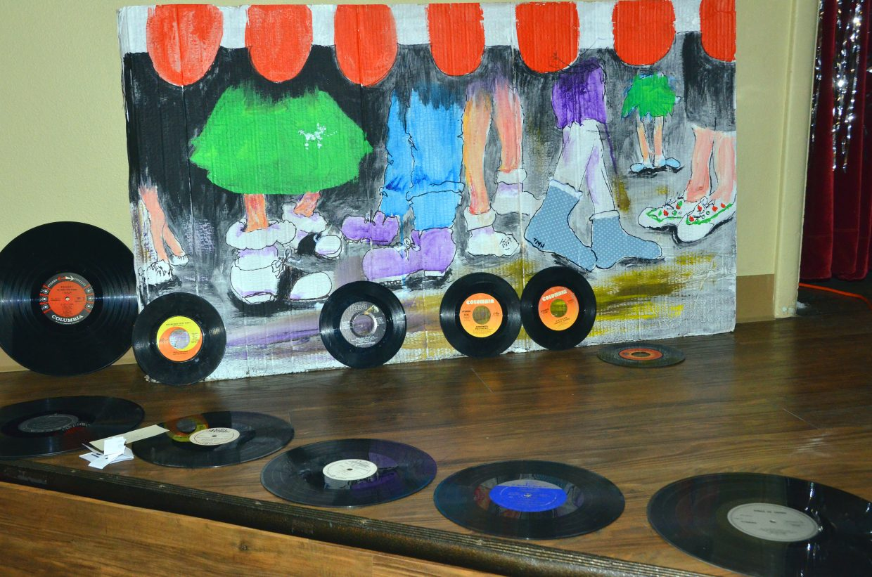 A collection of records is on display on stage during the Sock Hop fundraiser for the Senior Social Center held Saturday night at the Moffat County Fairgrounds Pavilion. Craig DJ Frank Hanel provided period tunes for the event, among them favorites like Elvis Presley and Buddy Holly, as participants dressed in poodle skirts, leather jackets and other 1950s and early '60s clothing.