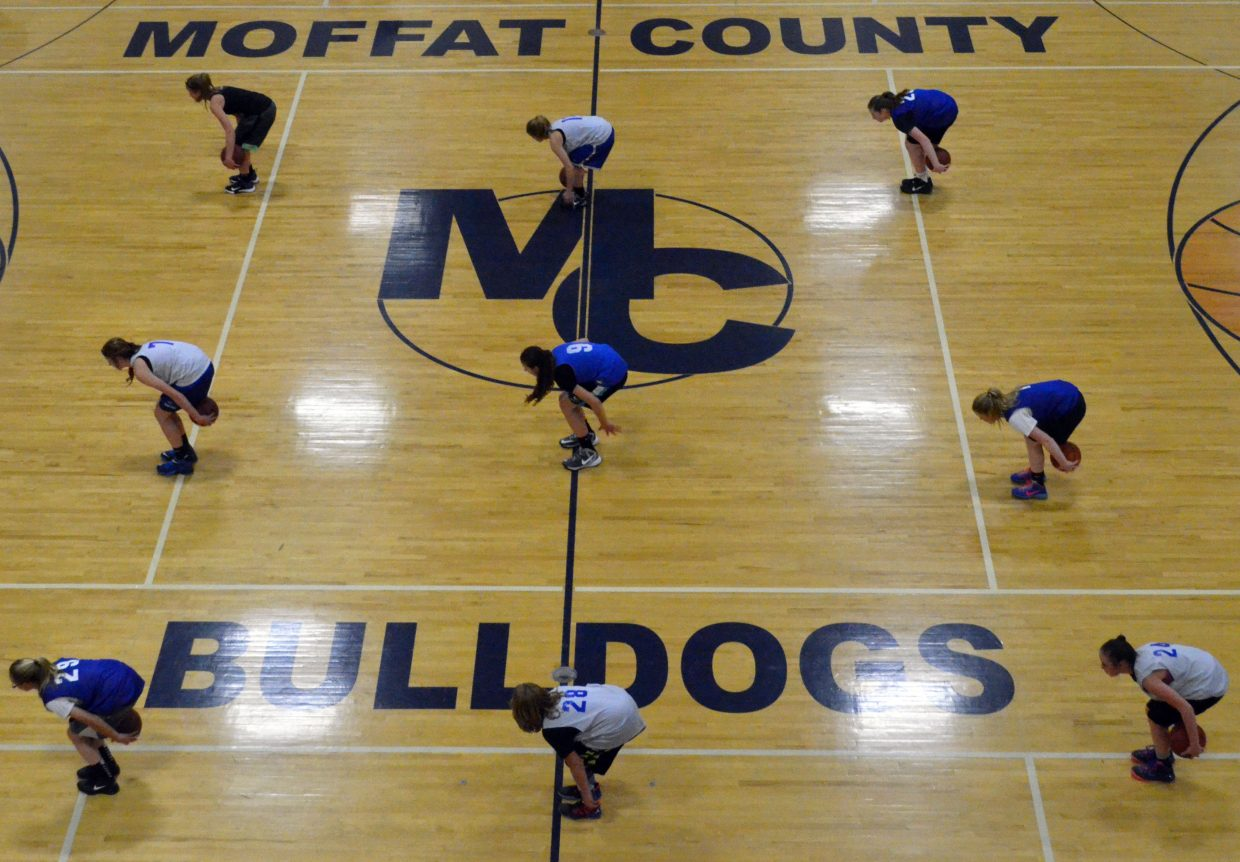 A bird's eye-view of the Moffat County High School gym as the members of the MCHS girls basketball program practice their skills with the ball.