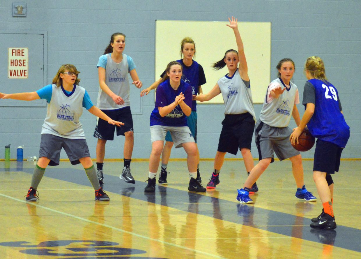The younger members of the Moffat County High School girls basketball team scrimmage among themselves as part of a practice session.