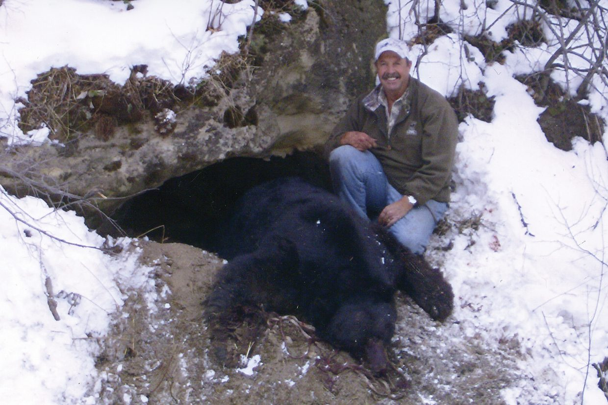 Richard Kendall poses with his trophy black bear Nov. 20 in the Wilson Creek area of Moffat County. Kendall went into the bear's cave and shot the animal twice.