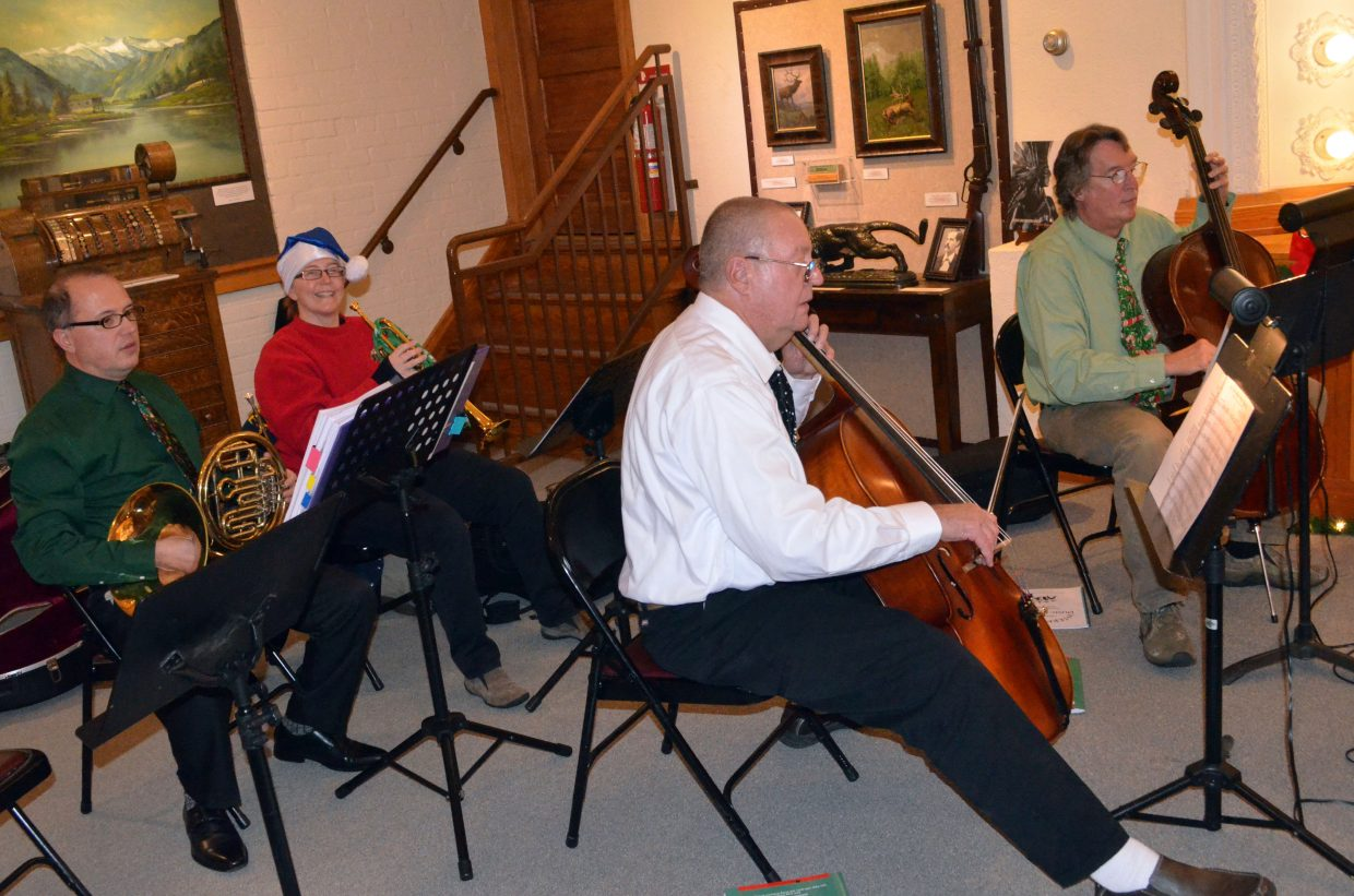 Musicians perform holiday tunes for patrons of Museum of Northwest Colorado during Saturday's Down Home Christmas Celebration.