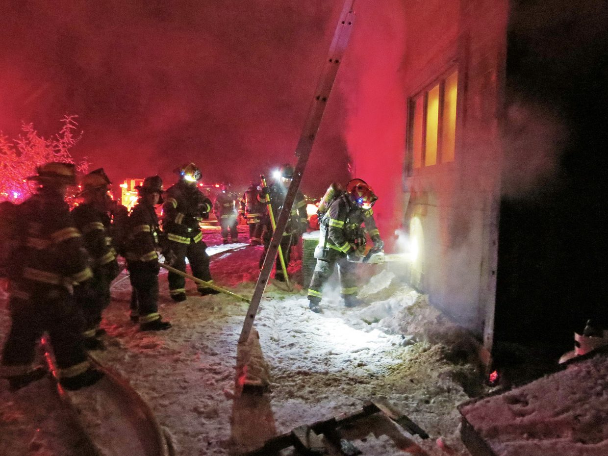 Craig Fire/Rescue firefighters work to contain a house fire at 780 Moffat County Road 30 on Saturday night.