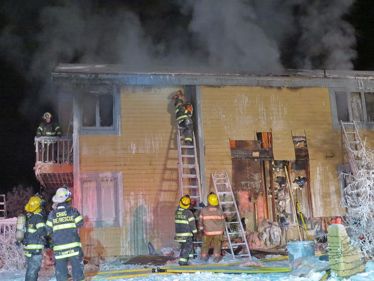 Firefighters from Craig Fire/Rescue work to extinguish a house fire in subzero temperatures.