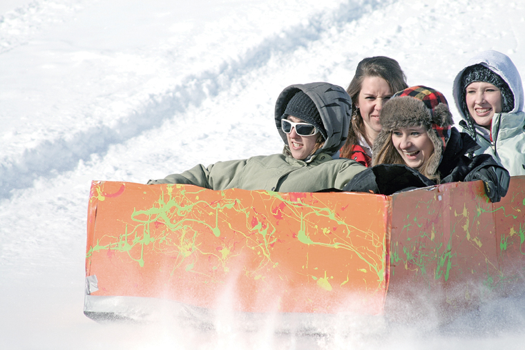 Clockwise from left, MCHS students Jessica Wiseman, Miranda Blomquist, Brittany Ivers and Michelle Stoffle compete in the 2011 Science Olympics Cardboard Sled Races.