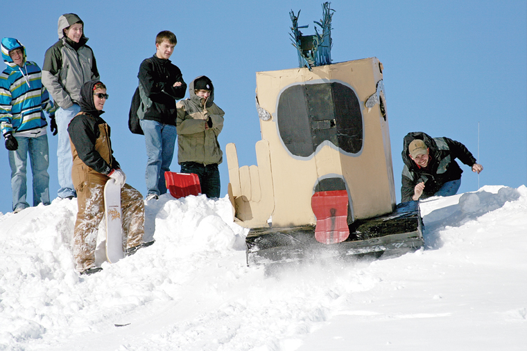 MCHS students watch as a student-made cardboard sled departs the starting line during the 2011 Science Olympics Cardboard Sled Races.