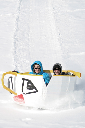 "MCHS seniors Kellie Looper, left, and Kaci Meek compete during the 2011 Science Olympics Cardboard Sled Races. The pair won for the most creative sled, called Chip, based on the Walt Disney animated film, ""Beauty and the Beast."""