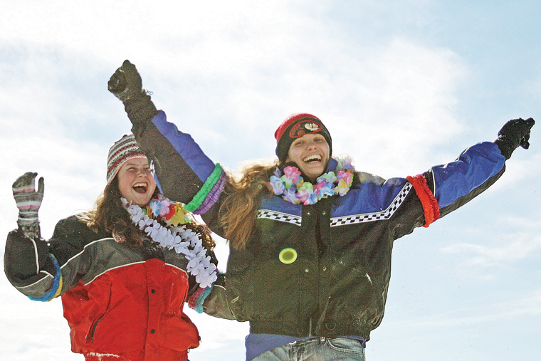 MCHS students Velvet Warne, left, and Aime Chadwick celebrate after their winning run at the 2011 Science Olympics Cardboard Sled Races.